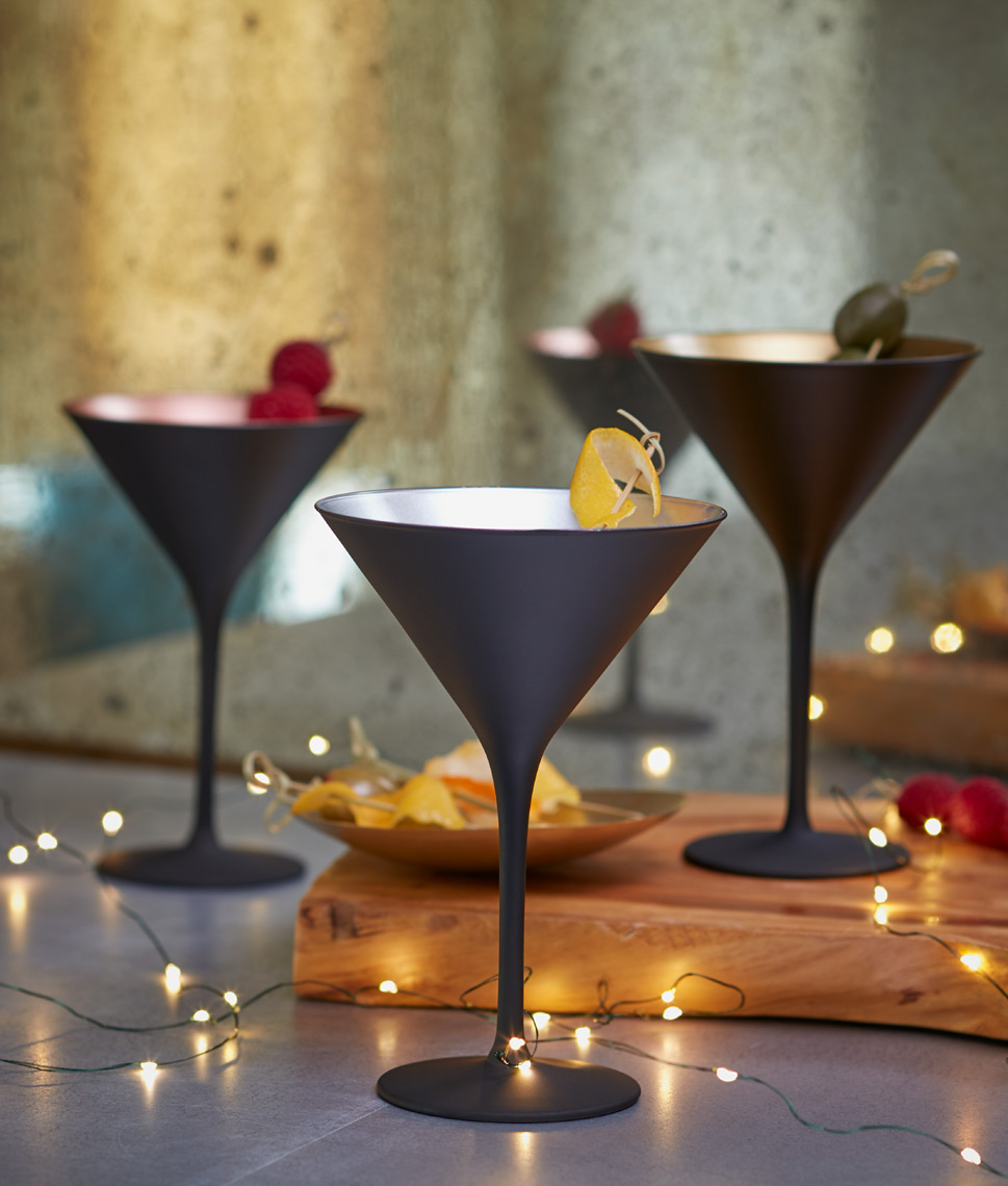 chic black martini glasses with fruit and Christmas lights