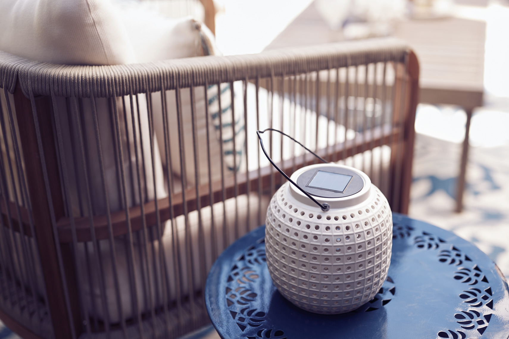 view of lantern on blue side table outside San Francisco product photographer