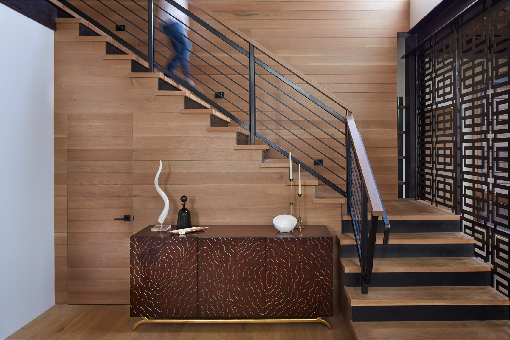 home interior with wooden sideboard and staircase