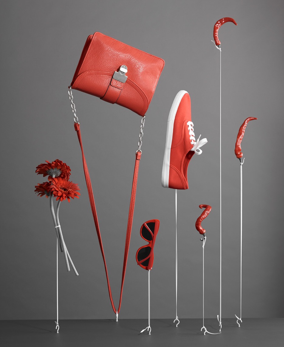 red handbag and other red accessories hanging upside down from white strings San Francisco product photographer