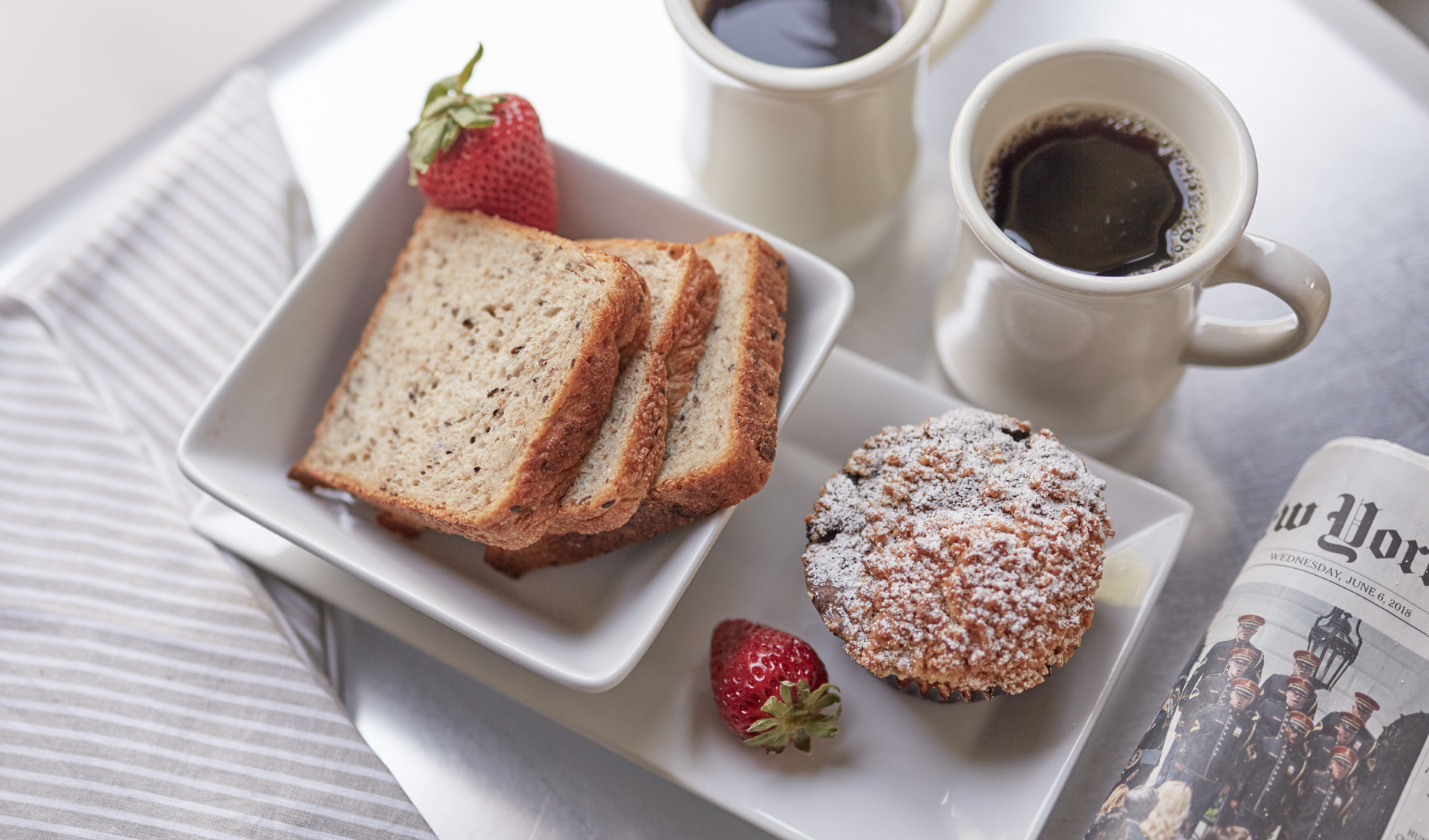 Totast and muffin and  morning coffee on white tray shot for Senza Hotel and Spa in Napa California