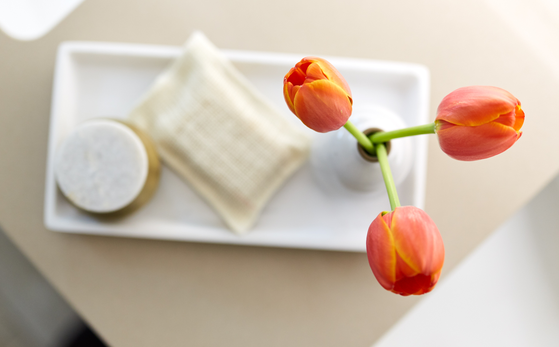 Orange tulips in Hotel bathroom on white tray shot for Senza Hotel and Spa in Napa California