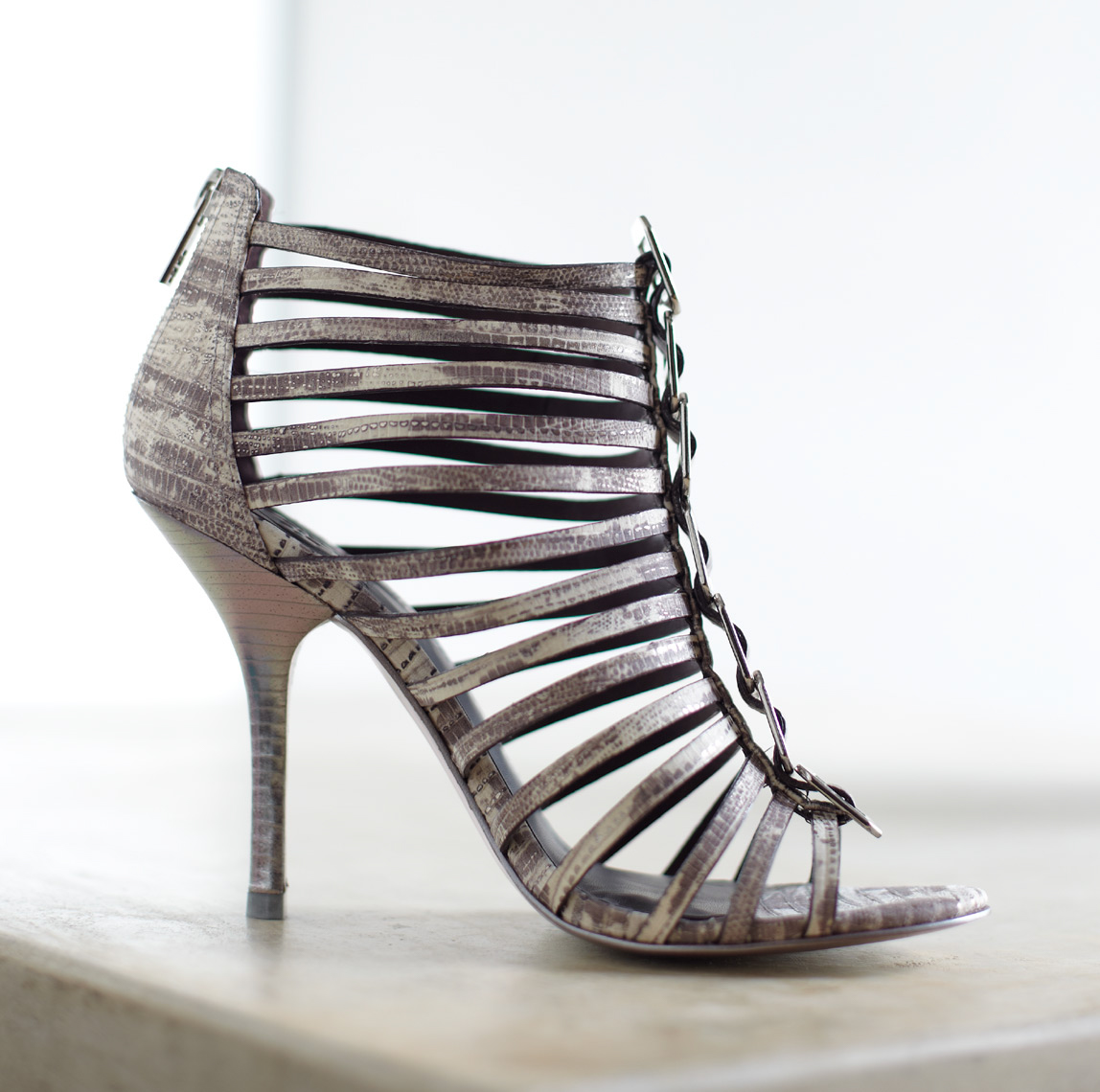 open-toed silver strappy heel on clean white countertop