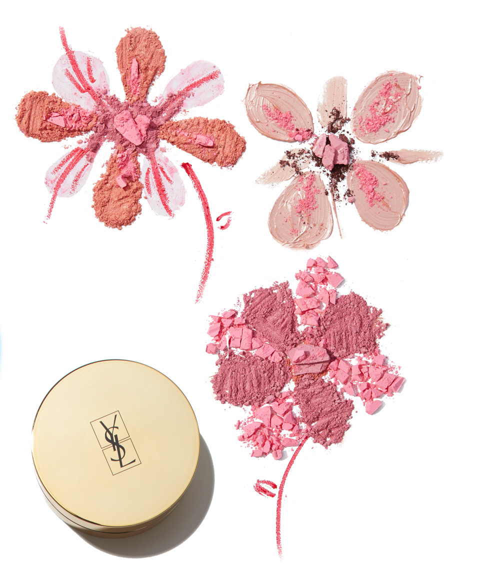 makeup powders of different colors forming floral patterns