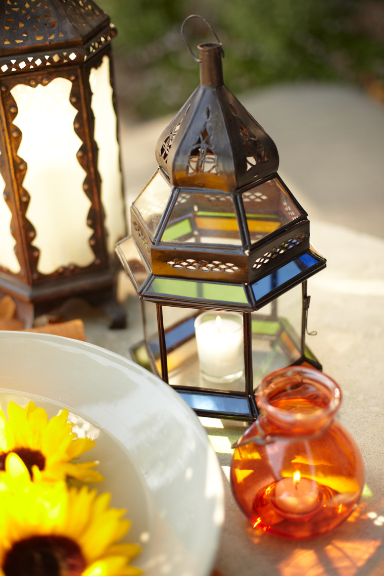 Moroccan lanterns with bowl of sunflowers