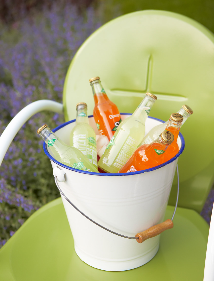 white bucket with colorful soda bottles sitting on green chair San Francisco food photographer