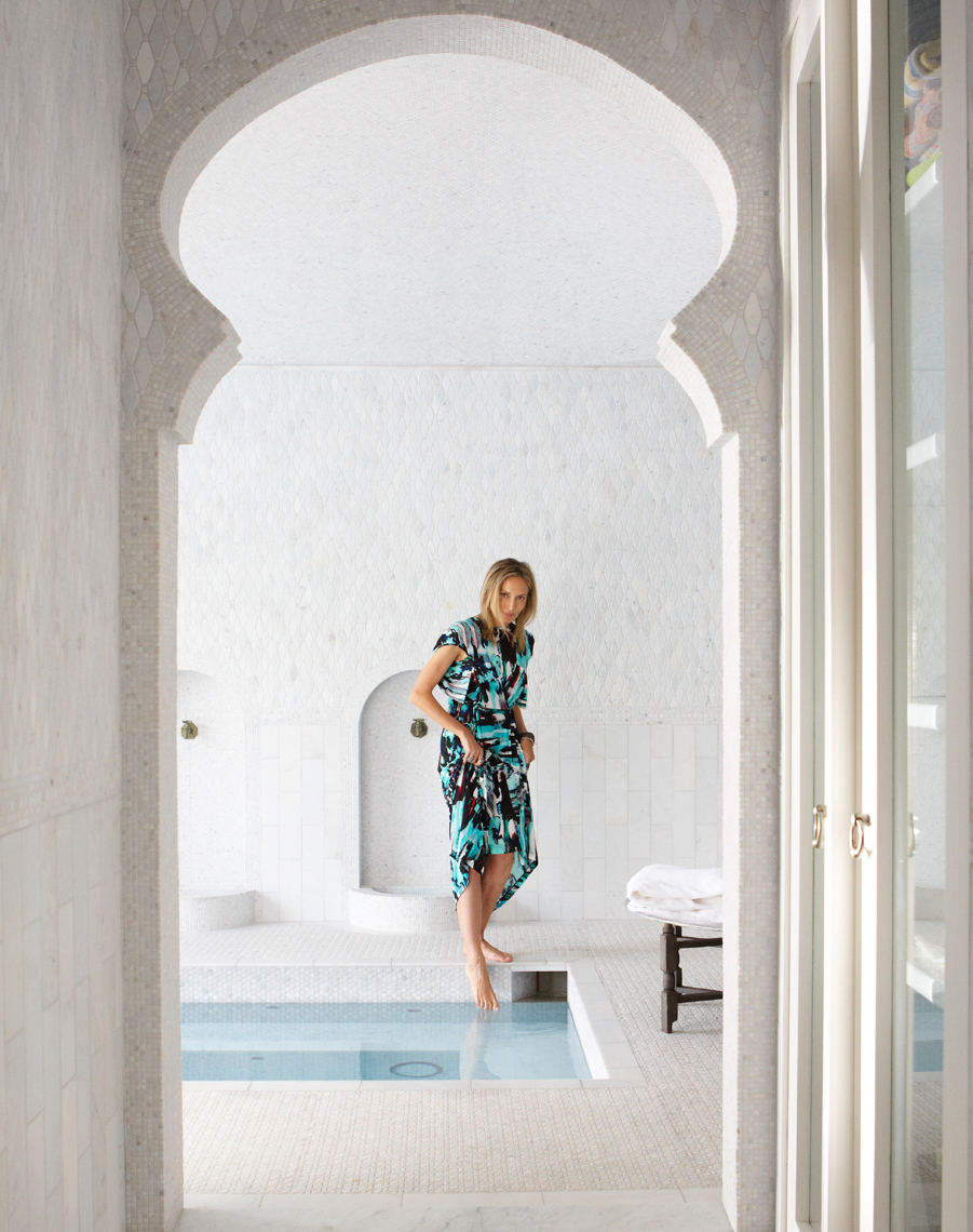 Woman in dress dipping her foot into a moroccan indoor pool San Francisco lifestyle photographer