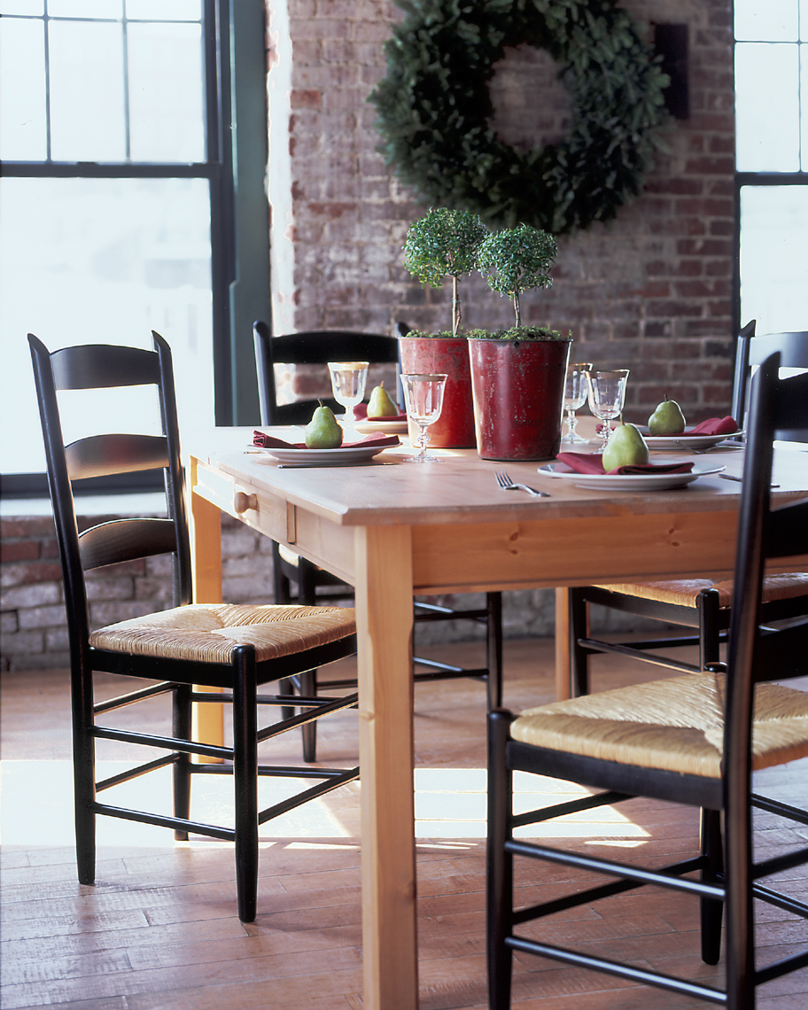 holiday table settings on wooden dining table with black painted wooden chairs San Francisco interior photographer