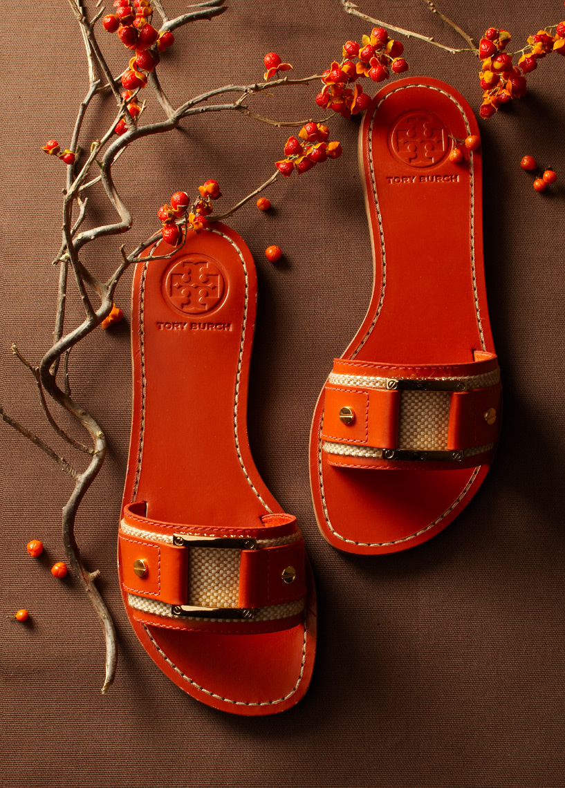 red single-strap sandals with twigs of holly San Francisco product photographer