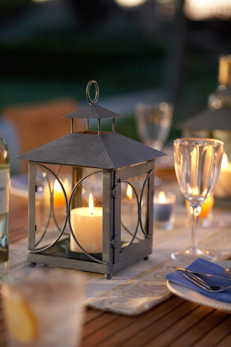 Detail of lantern with candle on set table at night