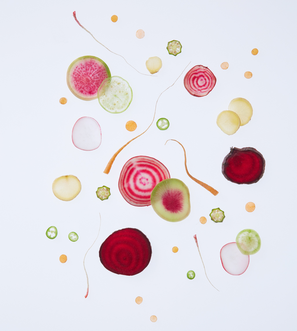 slices of fruit and vegetables laid out on a white surface San Francisco food photographer