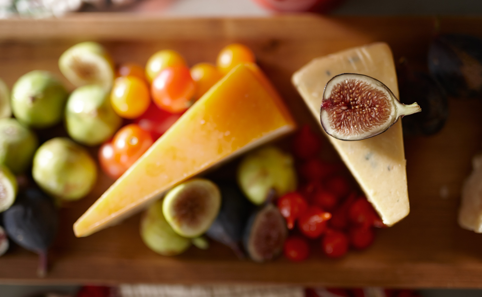 cheese with an assortment of figs