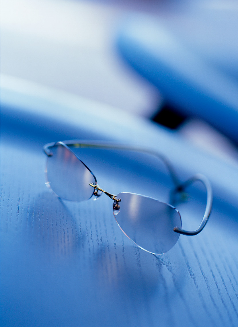 blue eyewear reflected on tinted surface