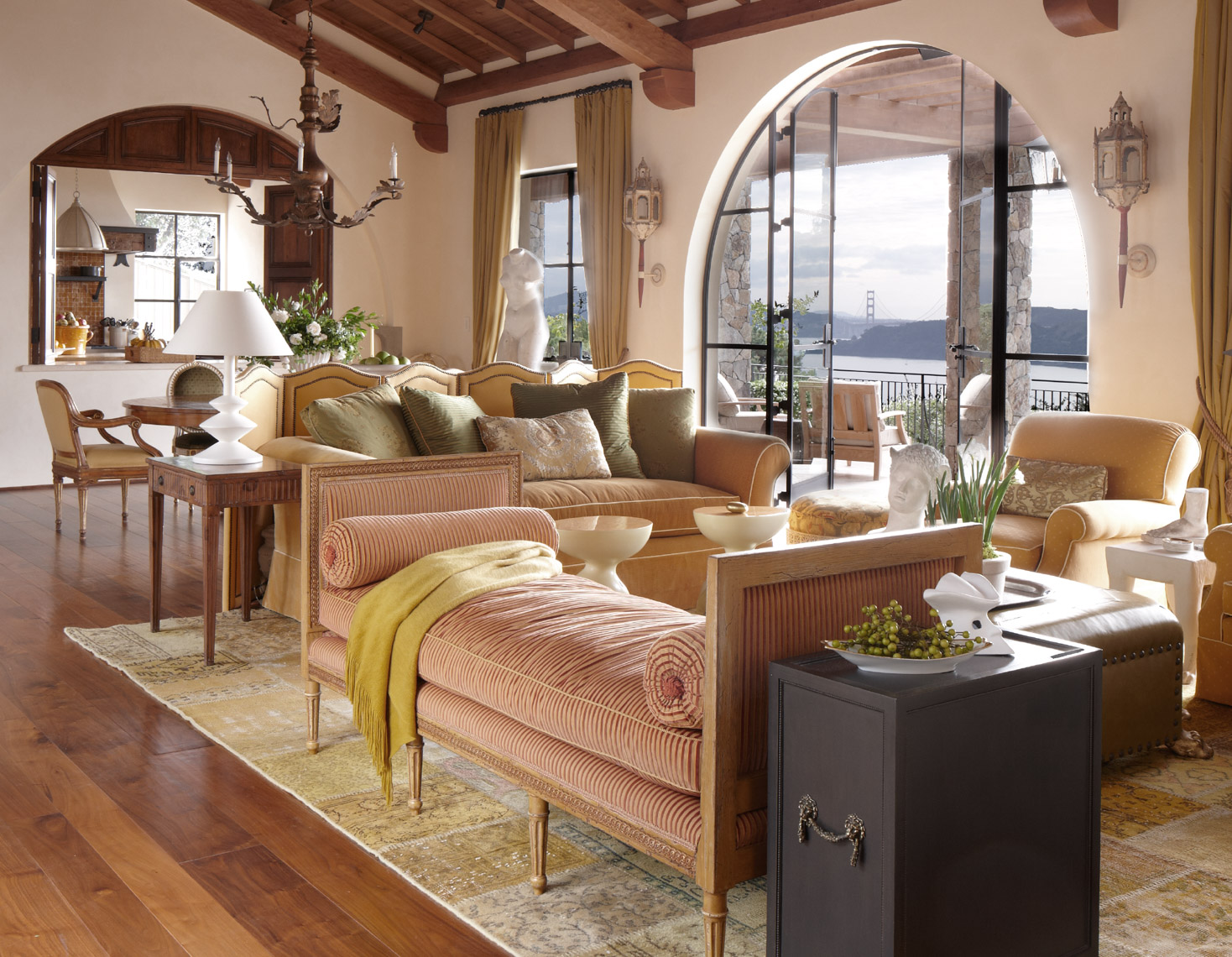 peach and yellow couches in warm living room interior overlooking ocean view