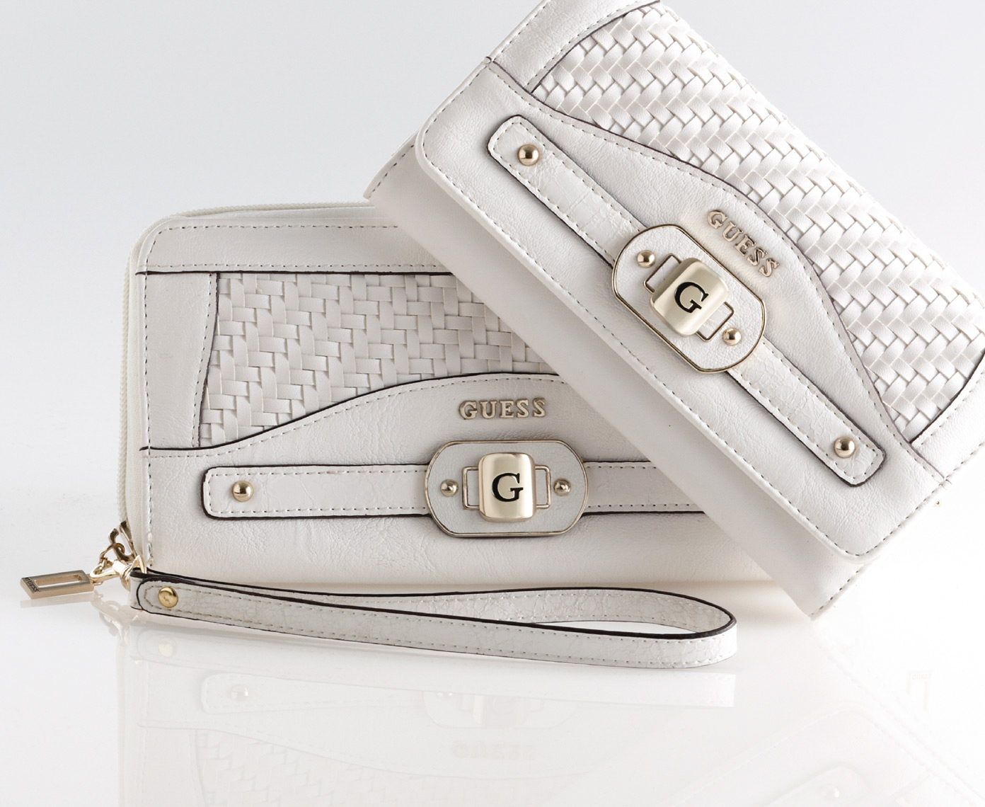 2 small white handbags with white wriststraps