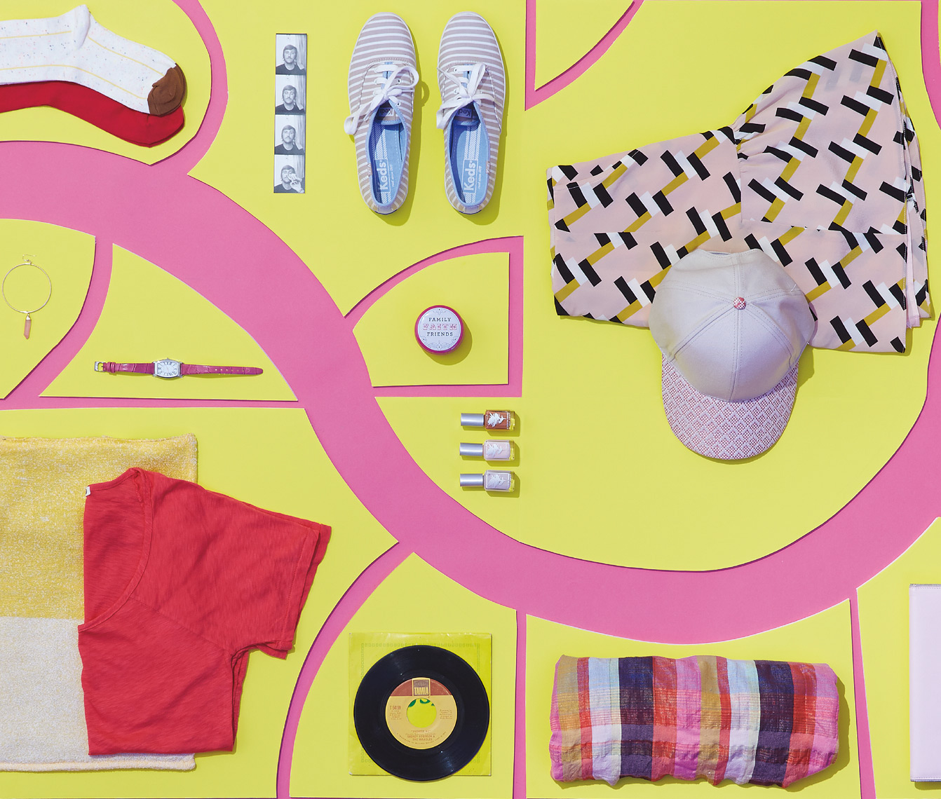 colorful clothing and accessories on yellow and pink paper cut-outs San Francisco product photographer