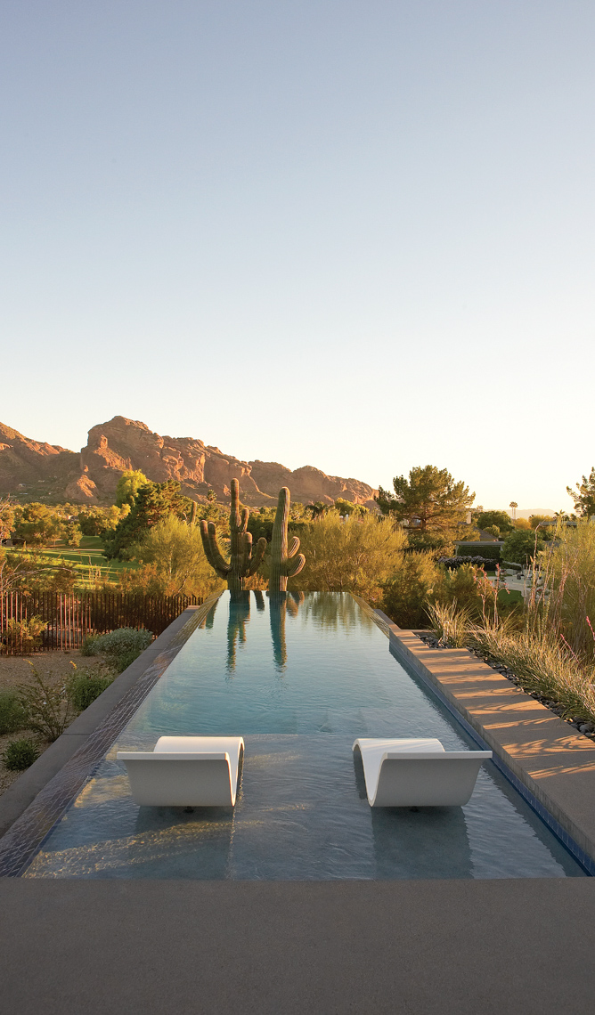 Modern white chaises in long pool in Arizona desert San Francisco architectural photographer