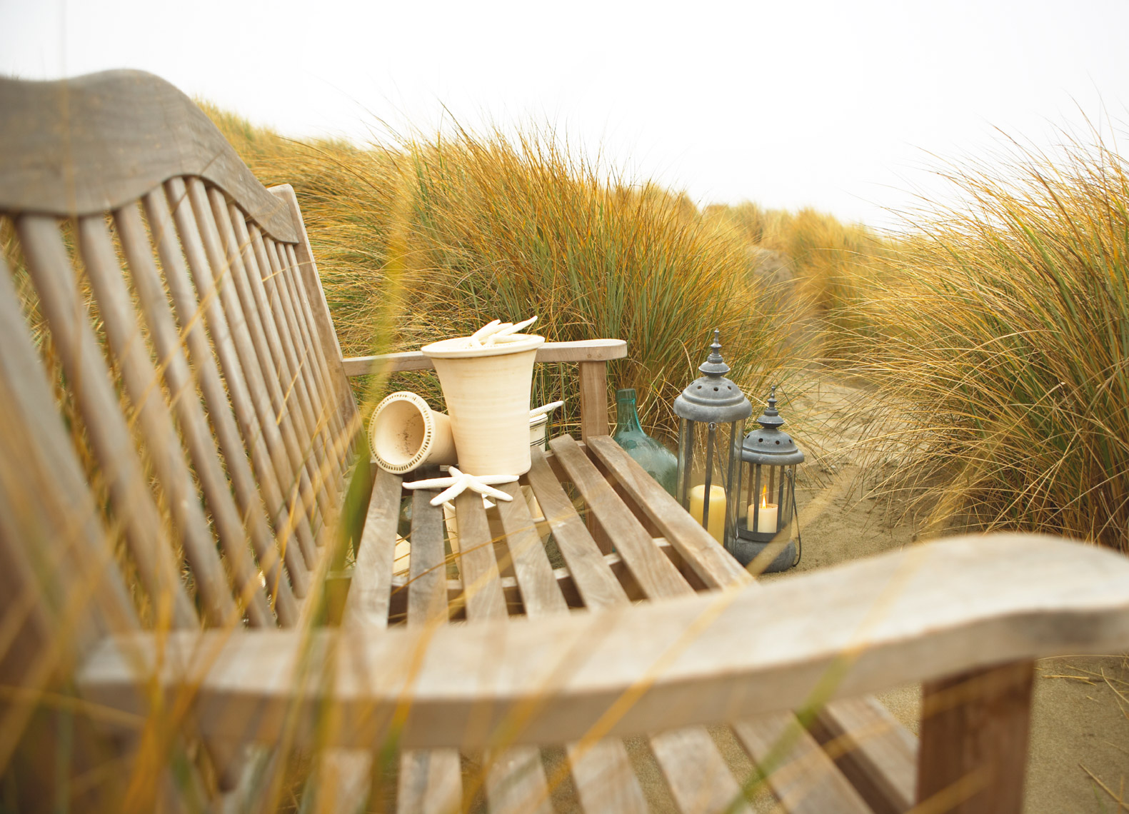 Teak bench in the dunes at sunrise