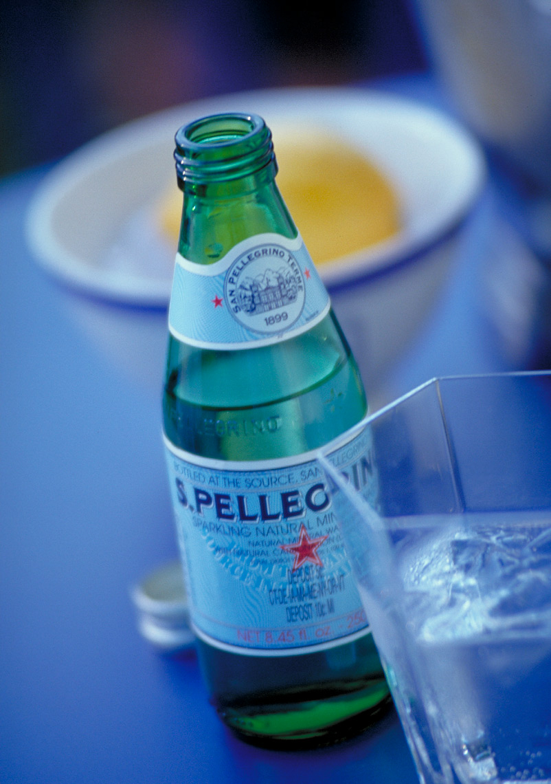 detail of a pellegrino bottle on table