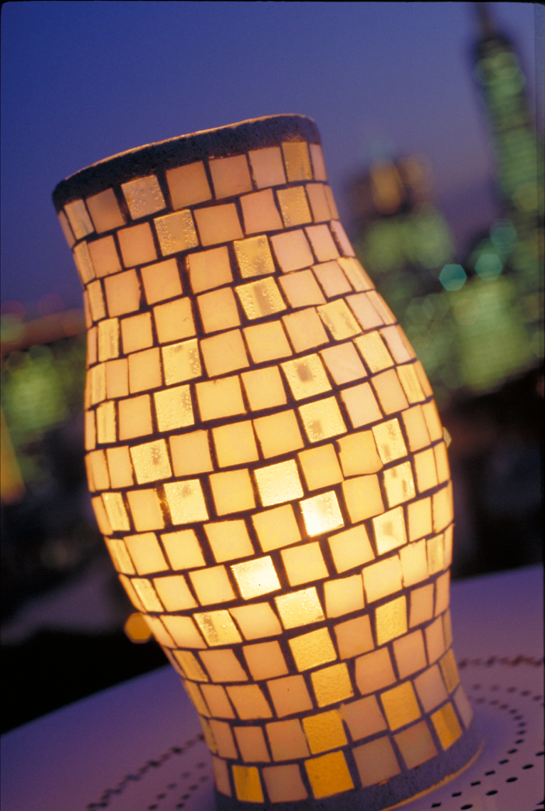 Tile lantern glowing at dusk